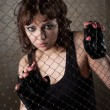 Stock Photo: Girl in cage