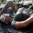 Stock Photo: Womlying in mud