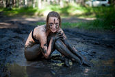 Woman lying in the mud — Stock Photo