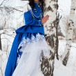 Girl in vintage dress in a snowy forest - Stockfoto
