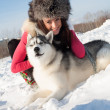 Royalty-Free Stock Photo: Portrait of a young girl with a Siberian husky