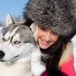 Portrait of a young girl with a Siberian husky — Stock Photo
