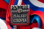 Master of Sports of Russia sign the athlete against the Russian flag — Stock Photo