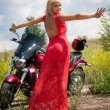 Blonde with a motorcycle — Stock Photo
