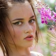 Beautiful young girl among the wildflowers — Stock Photo