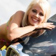 Stock Photo: Portrait of beautiful blonde with motorcycle