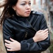 Young girl in a leather jacket on a background of ruins — Stock Photo