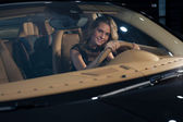 Blonde in expensive car — Stock Photo
