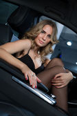 Beautiful blonde in the car — Stock Photo