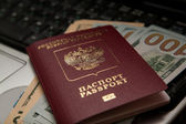 Russian passport with American dollars — Stock Photo