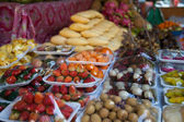 Tropical fruits and vegetables in the package on the market — Stock Photo