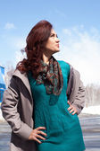Portrait of a girl in a coat and cravat — Stock Photo