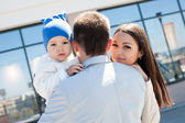Family on a walk in the city — Stock Photo