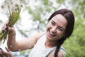 Girl with a bouquet of dandelions — Stock Photo