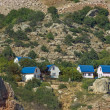 Cottages on mountain slope — Stock Photo #27275101