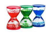 Three gel hourglasses — Stock Photo