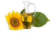 Sunflower and oil in glass decanter — Stock Photo