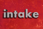 Palavra cinza na parede vermelha — Fotografia Stock