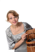 Woman holding a basket — Stock Photo