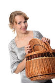 Woman holding a basket and smiling — Stock Photo