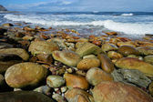 Rocky beach with waves — Stock Photo