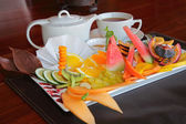 Fruit platter with tea — Stock Photo