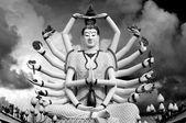 Eighteen arms Buddha over sky — Stock Photo