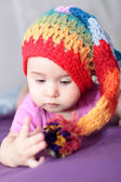 Baby girl in knit hat — Stock Photo