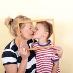 Pregnant woman kisses her son — Stock Photo #48710279