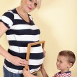 Pregnant woman playing with son — Stock Photo #48710327