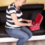 Pregnant woman preparing bag — Stock Photo #48710357