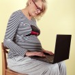 Pregnant woman with laptop — Stock Photo