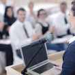 Business woman giving presentation — Stock Photo #10083355