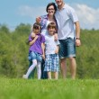 Happy young family have fun outdoors — Stock Photo #11697633