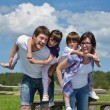 Happy young family have fun outdoors — Stock Photo #11699885