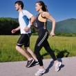 Young couple jogging — Stock Photo #12439545