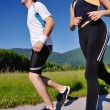 Young couple jogging — Stock Photo #12439570