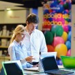 Young couple in consumer electronics store — Stock Photo #12445290