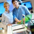 Young couple in consumer electronics store — Stock Photo #12445388