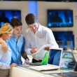 Young couple in consumer electronics store — Stock Photo #12449054