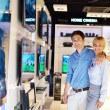 Young couple in consumer electronics store — Stock Photo #12450668