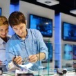 Young couple in consumer electronics store — Stock Photo #12453086