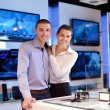 Young couple in consumer electronics store — Стоковая фотография