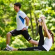 Couple doing stretching exercise after jogging — Stock Photo #12520169