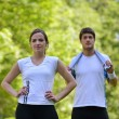 Couple doing stretching exercise  after jogging — Lizenzfreies Foto
