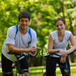Happy couple ridine bicycle outdoors — Stock Photo