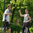 Happy couple ridine bicycle outdoors — Stock Photo #12523286