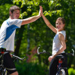 Happy couple ridine bicycle outdoors — Stock Photo #12523310