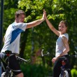 Happy couple ridine bicycle outdoors — 图库照片