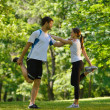 Stock Photo: Couple doing stretching exercise after jogging